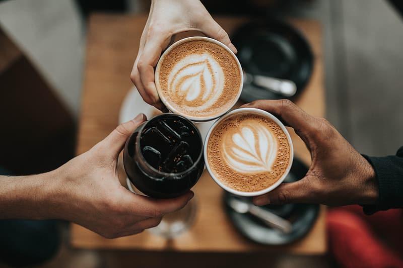 person-holding-cappuccino-in-white-ceramic-mug
